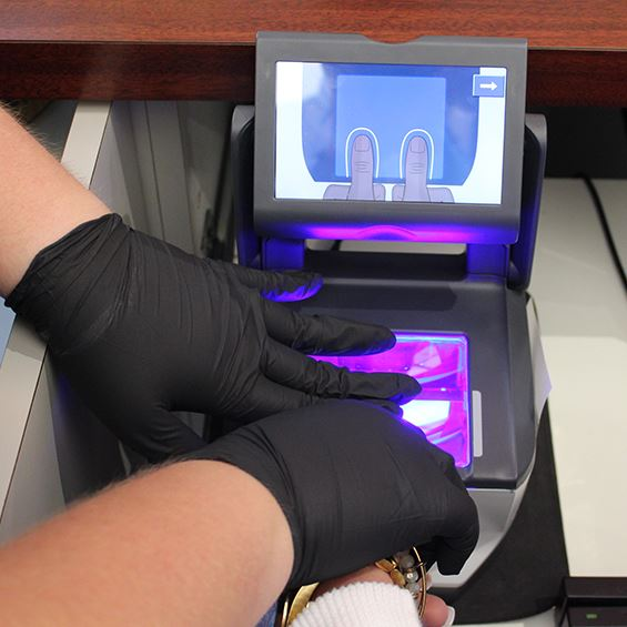 Photo of person being fingerprinted