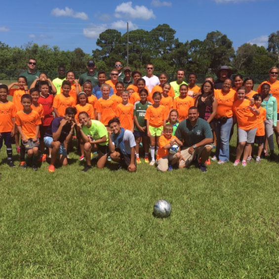 Photo of soccer camp participants with coaches.
